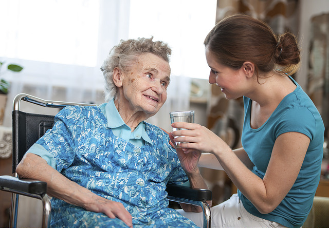 elderly woman and 24-hour home care aide