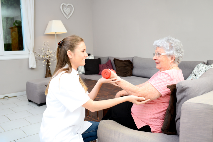 elderly woman with home health care physical therapist