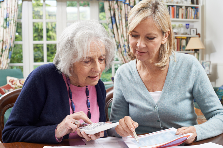 mother and daughter calculating assisted living