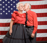 American square dancing couple in front of a flag